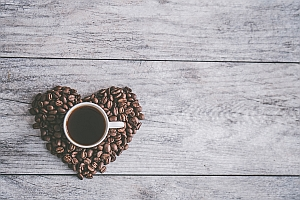 Coffee cupe in coffee beans heart